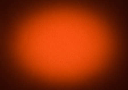 vignetted: Orange colour paper useful as a background vignetted