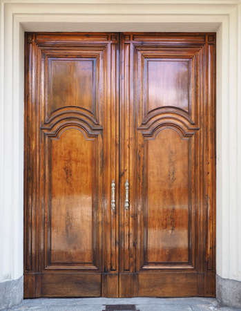 symmetrical: Ancient wooden door in symmetrical front view Stock Photo