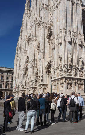 MILAN, ITALY - CIRCA APRIL 2016: Tourists queueing to visit Duomo di Milano (meaning Milan Cathedral) gothic church