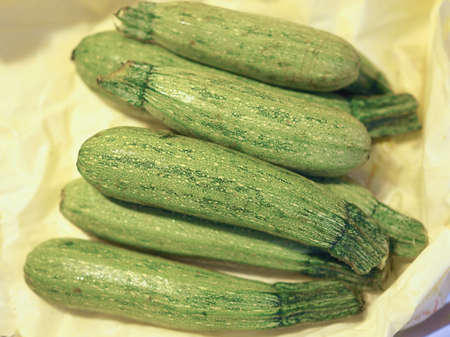 courgettes: Courgettes (Cucurbita pepo) aka zucchini vegetables vegetarian food Stock Photo