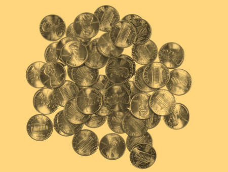 see the usa: Dollar coins 1 cent wheat penny cent currency of the United States isolated over white background - vintage sepia look Stock Photo