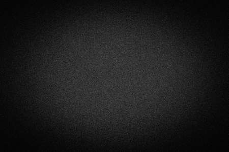 vignetted: Dark black background texture with shiny speckles of random noise vignetted