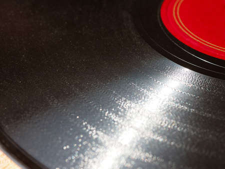 78 rpm: Detail of vintage 78 rpm music record isolated over white with copy space