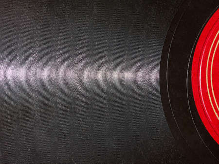 78: Detail of vintage 78 rpm music record isolated over white with copy space