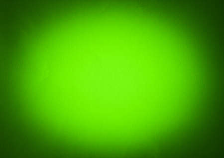 vignetted: Green colour paper useful as a background vignetted