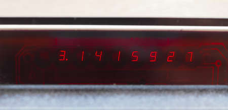 circumference: Pi constant on an LCD display of a scientific electronic pocket calculator Stock Photo
