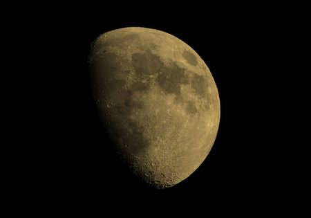 astrophoto: Gibbous moon over dark black sky seen with a telescope from northern emisphere at night vintage sepia