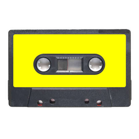 stereo cut: Magnetic tape cassette for audio music recording - isolated over white background - blank yellow label