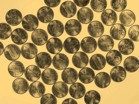 cent: Dollar coins 1 cent wheat penny cent currency of the United States useful as a background - vintage sepia look