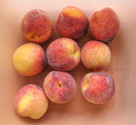 prunus: Orange peach (Prunus persica) fruit vegetarian food Stock Photo