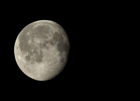 gibbous: Waning gibbous moon, almost full moon, seen with an astronomical telescope with copy space Stock Photo