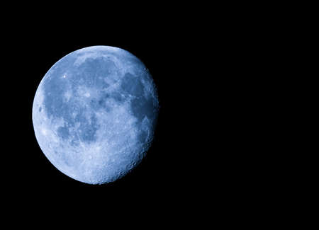 astronomical: Waning gibbous moon, almost full moon, seen with an astronomical telescope with copy space Stock Photo