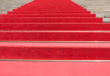 ceremonial: Red carpet on a stairway to mark the route of heads of state, vips and celebrities on ceremonial and formal occasions or events Stock Photo