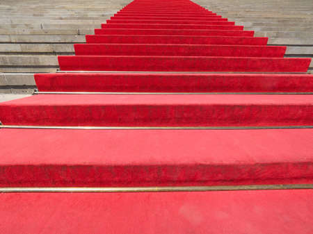 the celebrities: Red carpet on a stairway to mark the route of heads of state, vips and celebrities on ceremonial and formal occasions or events Stock Photo