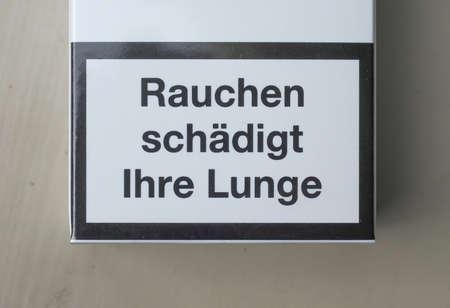 lunge: Rauchen schaedigt Ihre Lunge (meaning Smoking harms your lungs) written on a packet of cigarettes in Germany Stock Photo
