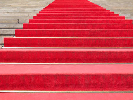 occasions: Red carpet on a stairway to mark the route of heads of state, vips and celebrities on ceremonial and formal occasions or events Stock Photo