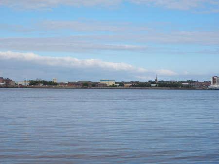 across: View of Birkenhead skyline across the Mersey river in Liverpool, UK Stock Photo