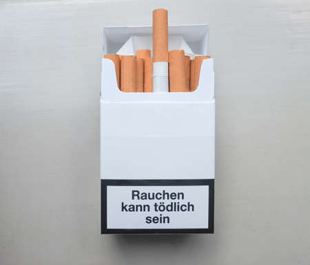 danger box: Rauchen schaedigt Ihre Lunge (meaning Smoking harms your lungs) written on a packet of cigarettes in Germany Stock Photo