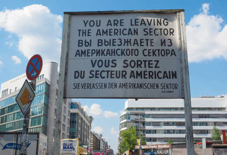 west germany: BERLIN, GERMANY - CIRCA JUNE 2016: Checkpoint Charlie (aka Checkpoint C) wall crossing point between East Berlin and West Berlin during the Cold War