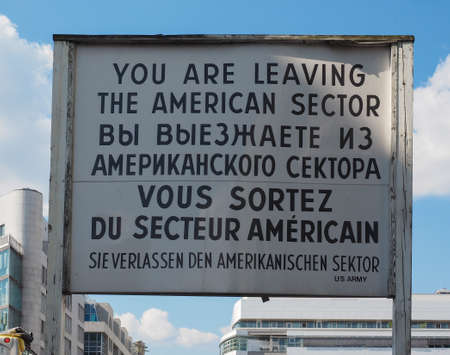 checkpoint: BERLIN, GERMANY - CIRCA JUNE 2016: Checkpoint Charlie (aka Checkpoint C) wall crossing point between East Berlin and West Berlin during the Cold War