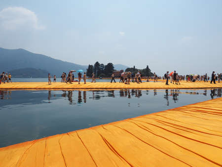 specific clothing: LAKE ISEO, ITALY - CIRCA JUNE 2016: The Floating Piers site specific landscape artwork by Christo and Jeanne Claude Editorial