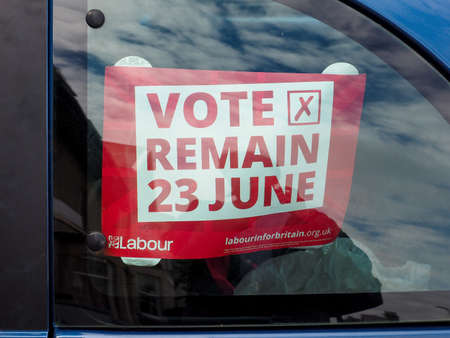 remain: LONDON, UK - CIRCA JUNE 2016: Vote Remain poster for 23 June Referendum on Brexit (meaning Britain Exit) on a car window Editorial