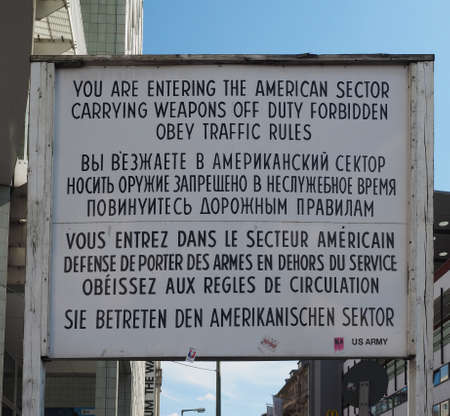 east berlin: BERLIN, GERMANY - CIRCA JUNE 2016: Checkpoint Charlie (aka Checkpoint C) wall crossing point between East Berlin and West Berlin during the Cold War