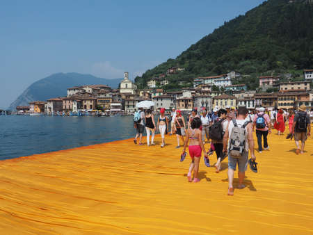 specific: LAKE ISEO, ITALY - CIRCA JUNE 2016: The Floating Piers site specific landscape artwork by Christo and Jeanne Claude Editorial