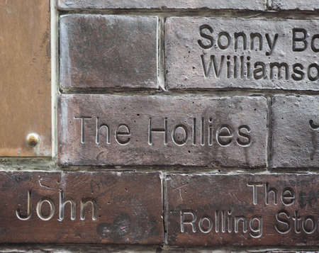 the beatles: LIVERPOOL, UK - CIRCA JUNE 2016: The Wall of Fame at the Cavern Pub opposite the Cavern Club where The Beatles played. Detail of the Hollies tile. Editorial