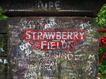 the beatles: LIVERPOOL, UK - CIRCA JUNE 2016: Strawberry Field gate in Beaconsfield Road in Woolton made famous by The Beatles song Strawberry Fields Forever on their 1967 album Magical Mystery Tour