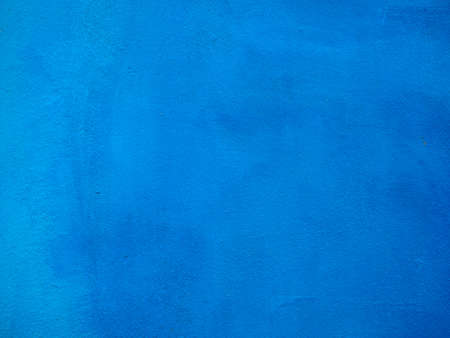 painted background: Blue painted plaster wall texture useful as a background