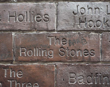 played: LIVERPOOL, UK - CIRCA JUNE 2016: The Wall of Fame at the Cavern Pub opposite the Cavern Club where The Beatles played. Detail of The Rolling Stones tile. Editorial