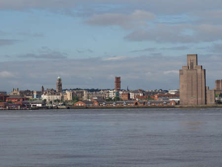 mersey: View of Birkenhead skyline across the Mersey river in Liverpool, UK Stock Photo