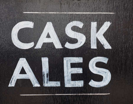 real ale: Cask ales sign outside a British pub serving real ale