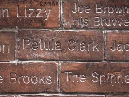 played: LIVERPOOL, UK - CIRCA JUNE 2016: The Wall of Fame at the Cavern Pub opposite the Cavern Club where The Beatles played. Detail of the Petula Clark tile.