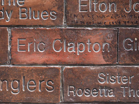 the beatles: LIVERPOOL, UK - CIRCA JUNE 2016: The Wall of Fame at the Cavern Pub opposite the Cavern Club where The Beatles played. Detail of the Eric Clapton tile.
