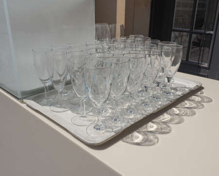 whine: Many champagne glasses at outdoor alfresco bar