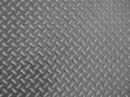diamond plate: Grey steel diamond plate useful as a background in black and white