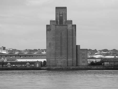mersey: View of Birkenhead skyline across the Mersey river in Liverpool, UK in black and white