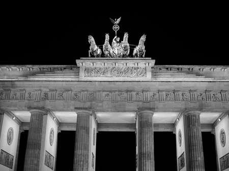 brandenburg gate: Brandenburger Tor meaning Brandenburg Gate in Berlin, Germany at night in black and white