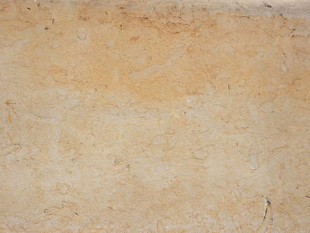 yellow stone: Yellow stone wall useful as a background
