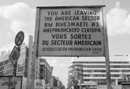 west germany: BERLIN, GERMANY - CIRCA JUNE 2016: Checkpoint Charlie (aka Checkpoint C) wall crossing point between East Berlin and West Berlin during the Cold War in black and white Editorial