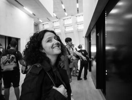 powerstation: LONDON, UK - CIRCA JUNE 2016: Woman visiting the newly opened Switch House at Tate Modern art gallery in South Bank power station in black and white