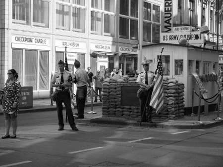 checkpoint: BERLIN, GERMANY - CIRCA JUNE 2016: Checkpoint Charlie (aka Checkpoint C) wall crossing point between East Berlin and West Berlin during the Cold War in black and white Editorial