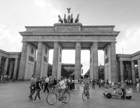 brandenburg gate: BERLIN, GERMANY - CIRCA JUNE 2016: Tourists in front of Brandenburger Tor meaning Brandenburg Gate in black and white Editorial