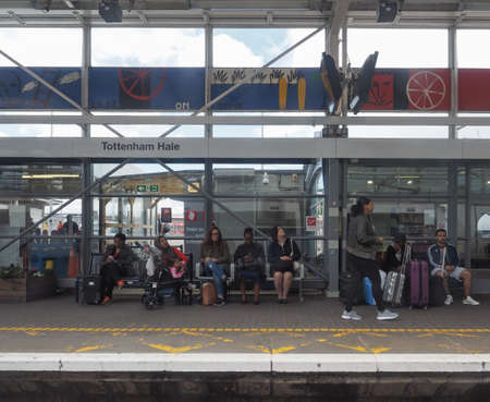 hale: LONDON, UK - CIRCA JUNE 2016: People waiting for transport at Tottenham Hale station platform