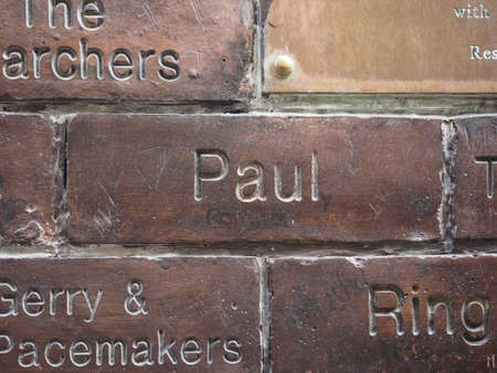 played: LIVERPOOL, UK - CIRCA JUNE 2016: The Wall of Fame at the Cavern Pub opposite the Cavern Club where The Beatles played. Detail of Paul McCartney tile. Editorial