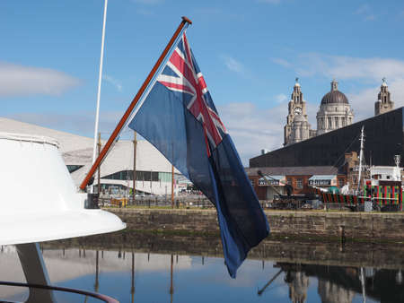 ensign: LIVERPOOL, UK - CIRCA JUNE 2016: Plain British Blue Ensign flag, used by the navy. It includes the Union Jack in its design.