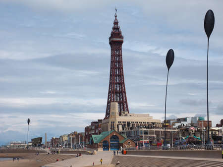 lancashire: BLACKPOOL, UK - CIRCA JUNE 2016: Blackpool Pleasure Beach resort and Blackpool Tower on the Fylde coast in Lancashire