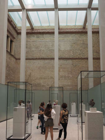 neues: BERLIN, GERMANY - CIRCA JUNE 2016: Tourists visiting the Neues Museum meaning New Museum in Museumsinsel in Berlin Germany